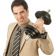 Businessman lifting a dumbbell - Stock Photo