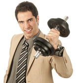 Businessman lifting a dumbbell — Stock Photo