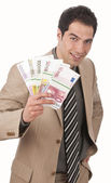 Businessman with bundle of money — Stock Photo