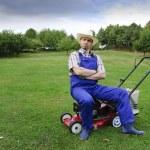 Gardening, man mowing the lawn — Stock Photo