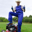 Gardening, man mowing the lawn — Stock Photo #20429131