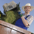 Man in the garden, compost bin - Stock Photo