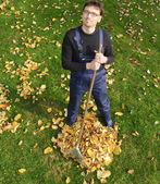 Gardening, raking leaves in the fall — Stock Photo