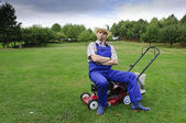 Gardening, man mowing the lawn — Stock Photo