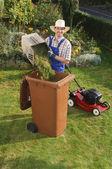 Man in the garden, compost bin — Stock Photo