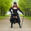 Plus size model wearing fancy dress in Park — Stock Photo