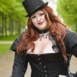 Plus size with black top-hat — Stok fotoğraf