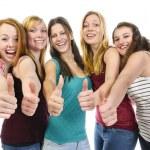 Girlfriends doing Thumbs Up — Stock Photo