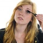 Girl applying Mascara — Stock Photo