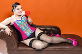 Candy Girl on Chaiselongue — Stock Photo
