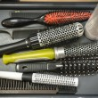 Stock Photo: Comb brushes with hair