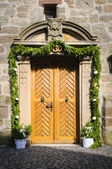 Church door decorated — Stock Photo