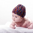 Close-up of sweet little newborn baby face with stocking cap — Stock Photo
