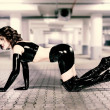 Woman in latex clothes on floor — Stock Photo