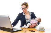 Businesswoman with baby and PC — Stock Photo