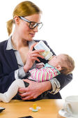 Woman gives baby the bottle — Stock Photo