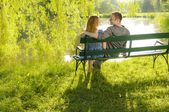 In love on the park bench — Stock Photo
