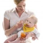 Baby gets porridge — Stock Photo #50639503
