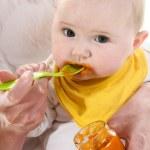 Baby gets porridge — Stock Photo #50639525