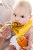 Baby gets porridge — Stock Photo