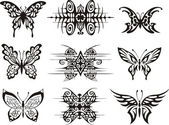 Set of symmetric butterfly tattoos — Stock Vector