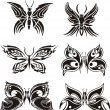 Stock Vector: Symmetric butterfly tattoos