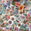 Backdrop of old U.S. postage stamps - Foto Stock