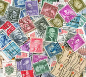 Backdrop of old U.S. postage stamps — Stock Photo