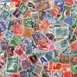 Background of old used Latin American postage stamps — Stock Photo