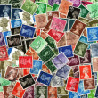 Background of old used British postage stamps — Stock Photo