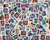 Francobolli canadesi con bandiera nazionale — Foto Stock