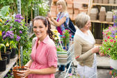 Woman hold potted plant at garden shop — Stock Photo