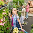 Woman shopping for flowers in garden shop — Stock Photo #12060004