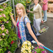 Woman at garden centre shopping for flowers — Stock Photo
