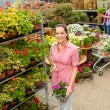 Garden centre woman shopping plants — Stock Photo