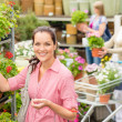Royalty-Free Stock Photo: Woman buying potted flower in garden shop