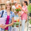 Woman hold flower pot garden centre store  — Stock Photo