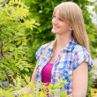 Stock Photo: Woman hold tree plant at garden store