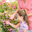 Botanic garden child mother looking at flowers — Stock Photo #12060185