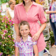 Stock Photo: Garden centre child mother at plant market