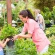 Garden center child mother shopping flowers plant — Stock Photo