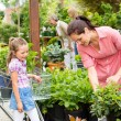 Garden centre child mother shopping flowers plant — Stock Photo