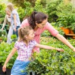 Stock Photo: Mother daughter choosing flowers in garden shop