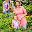 Royalty-Free Stock Photo: Mother daughter shopping flowers in garden center