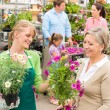 Customer at garden centre buying potted flowers — Foto de Stock