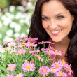 Portrait of beautiful woman with purple flowers - Stock fotografie