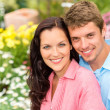 Stock Photo: Happy couple embracing in nature garden