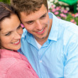 Happy couple hugging in blooming garden — Stock Photo