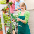Florist at garden center retail inventory — Stock Photo