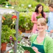Florist at garden centre retail inventory — Stock Photo